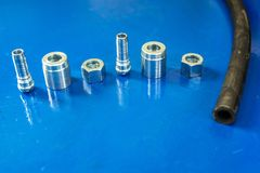 Aluminum disassembled parts of high pressure hose with fittings stock image