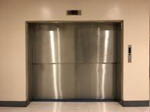 Aluminum door, elevator. Aluminum elevator door at supermarket Stock Image