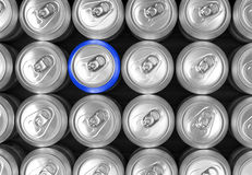 Aluminum drink cans and one blue can Stock Photo