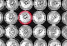 Aluminum drink cans and one red can. Stock Images