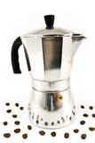 Aluminum espresso coffee maker with coffee beans Royalty Free Stock Photos