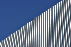 Aluminum fence. Against blue sky, diagonal view Royalty Free Stock Image