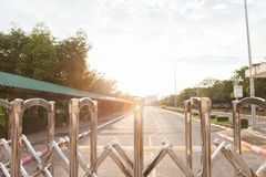 Aluminum fence Luster It is used for shutting down entrances and exits in places. Where no cars are allowed. and have road has a long straight is background stock photography