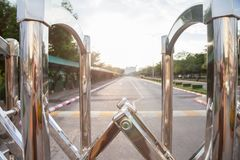Aluminum fence Luster It is used for shutting down entrances and exits in places. Where no cars are allowed. and have road has a long straight is background royalty free stock images