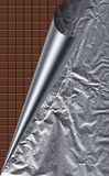 Aluminum foil with chocolate table Royalty Free Stock Images