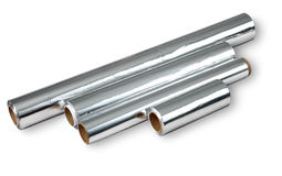 Aluminum foil for cooking and storing food, four rolls. Royalty Free Stock Image