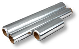 Aluminum foil for cooking and storing food, four rolls. Stock Images