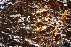 Aluminum foil texture. Glide view. Gold Stock Photos