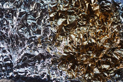 Aluminum foil texture. Glide view. Half gold, half silver Royalty Free Stock Images