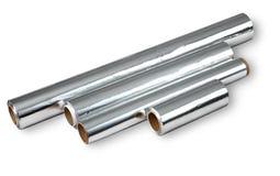 Aluminum folie för att laga mat och att lagra mat, fyra rullar. Royaltyfri Bild