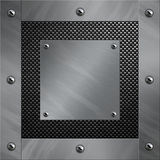 Aluminum frame bolted to a carbon fiber. Brushed aluminum frame and plate bolted to a carbon fiber background Royalty Free Stock Photo