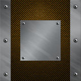 Aluminum frame bolted to a carbon fiber. Brushed aluminum frame and plate bolted to a carbon fiber background Royalty Free Stock Photography