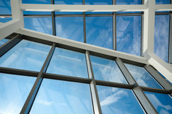 Aluminum and glass construction. Modern office building glass ceiling against blue skies Royalty Free Stock Images