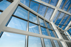 Aluminum and glass construction. Modern office building glass ceiling against blue skies Stock Image