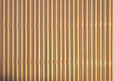 Aluminum golden corrugated metal wall. Golden colored aluminum corrugated goffered metal wall texture background Royalty Free Stock Photos