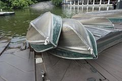 Rowboats for rent to paddle in lake. Aluminum green paddle boat rental in NYC Central Park stock photography