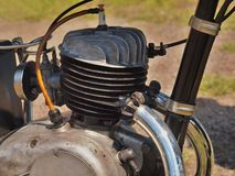 Aluminum head of old motorcycle engine, exhaust system Royalty Free Stock Images