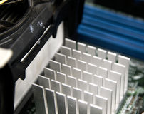 Aluminum heat sink on the disc as seen from up close. Royalty Free Stock Photos