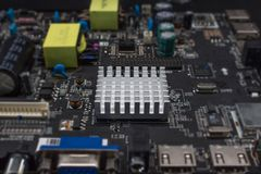 The aluminum heat sink on electronic board. The aluminum heat sink on electronic board Stock Photo