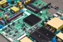 The aluminum heat sink on electronic board. The aluminum heat sink on electronic board Stock Image
