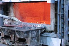 Aluminum industry castings works. Skimming melted aluminum for removing the dross before casting. Aluminum foundry works showing an open furnace stock images