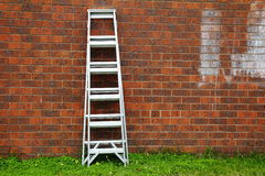 Aluminum ladder against the wall. Stock Image