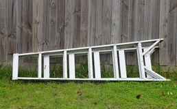 Aluminum ladder against the wall of wood Stock Photos