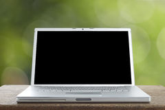 Aluminum Laptop on a wooden table Stock Photos