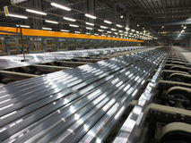 Aluminum lines on a conveyor belt. In a factory Stock Images
