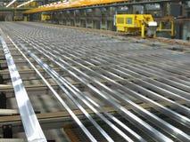 Aluminum lines on a conveyor belt Royalty Free Stock Photos