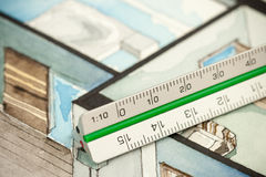Aluminum matte drafting ruler on isometric drawing Royalty Free Stock Photography