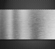 Aluminum metal plate over grill background Royalty Free Stock Photo