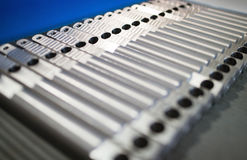 Aluminum metal raw material in the form of long rods Stock Photos