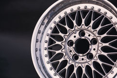 Aluminum metal wheel rim texture. Car alloy , isolated on g. Aluminum metal wheel rim texture. Car alloy wheel, isolated on black background. Classic drive Stock Image
