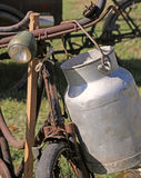 Aluminum Milk Canister used by farmers to carry cycling fresh mi. Old aluminum Milk Canister used by farmers to carry cycling fresh milk Royalty Free Stock Images
