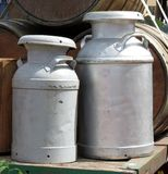 Aluminum Milk Cans. On an Old Wagon with Wooden Barrels Stock Photos