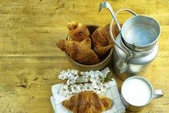 Aluminum milkcan witn organic milk and fresh baked croissants Royalty Free Stock Image