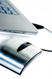 Aluminum mouse and laptop Stock Photography
