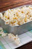 Aluminum plate full of salty popcorn on towel Stock Images