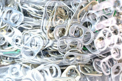 Aluminum pull tabs in bottle royalty free stock photo