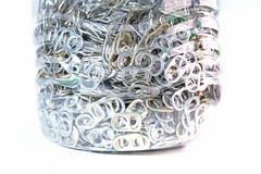 Aluminum pull tabs in bottle Royalty Free Stock Photography
