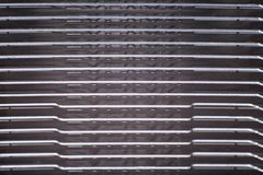 Aluminum radiator with copper heat pipe close-up with beautiful bokeh Royalty Free Stock Photo