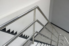 Aluminum railing. The Aluminum railing handle of staircase Royalty Free Stock Image