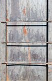 Aluminum Rungs with Rust. Outdoor aluminum ladder attached to aluminum wall surface Stock Images