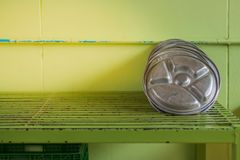 Aluminum school tray on the shelf. After washing completed royalty free stock image