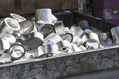 Aluminum scraps in a container Royalty Free Stock Images