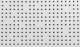 Aluminum sheet drilling small holes Royalty Free Stock Photography
