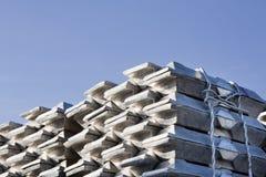 Aluminum. Shiny aluminum ingots and a blue sky stock photo