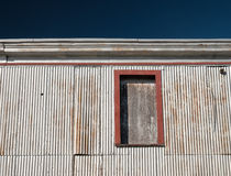 Aluminum sided old dockside structure in New England Stock Photos