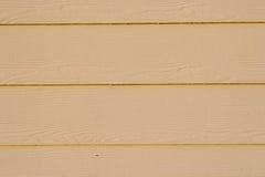 Aluminum Siding. Yellow, beige aluminum siding, in horizontal orientation Royalty Free Stock Photos